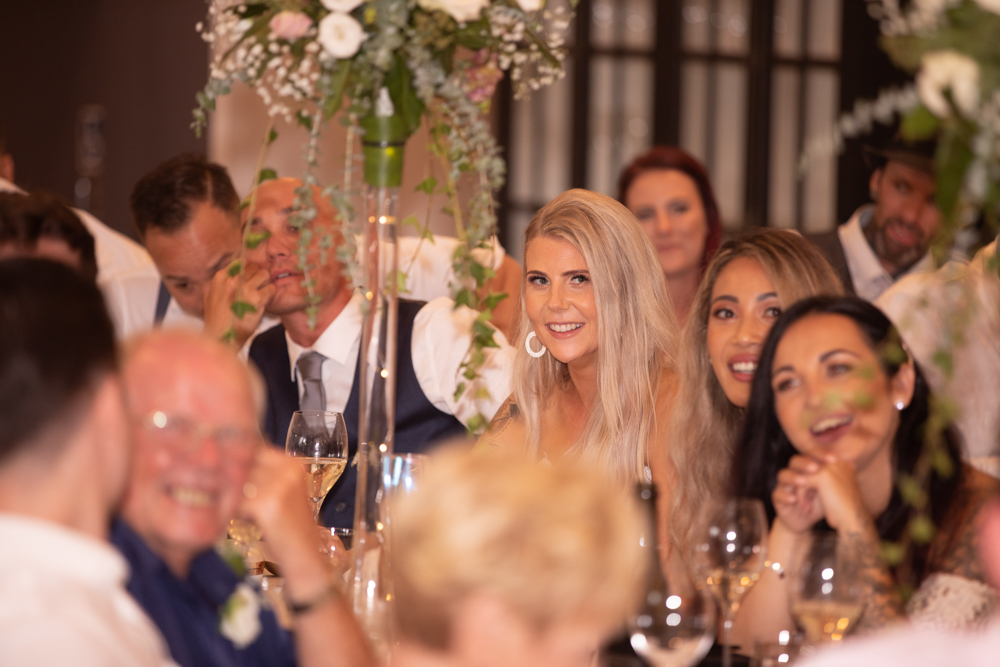 Bride laughing at her reception
