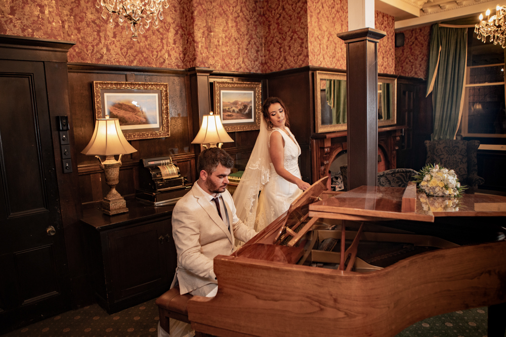 Groom plaing a piano for his bride Princes Gate Hotel Rotorua-21